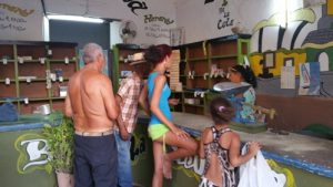 A state store where Cubans bring ration books to redeem coupons for food staples.