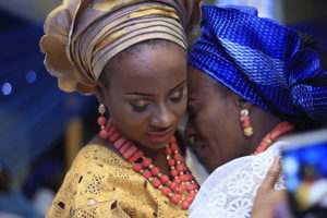 A Yoruba bride and her mother, wearing traditional dress