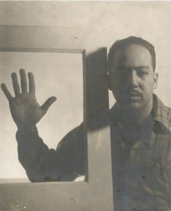 Langston Hughes, <br/>photographed by Gordon Parks in 1941